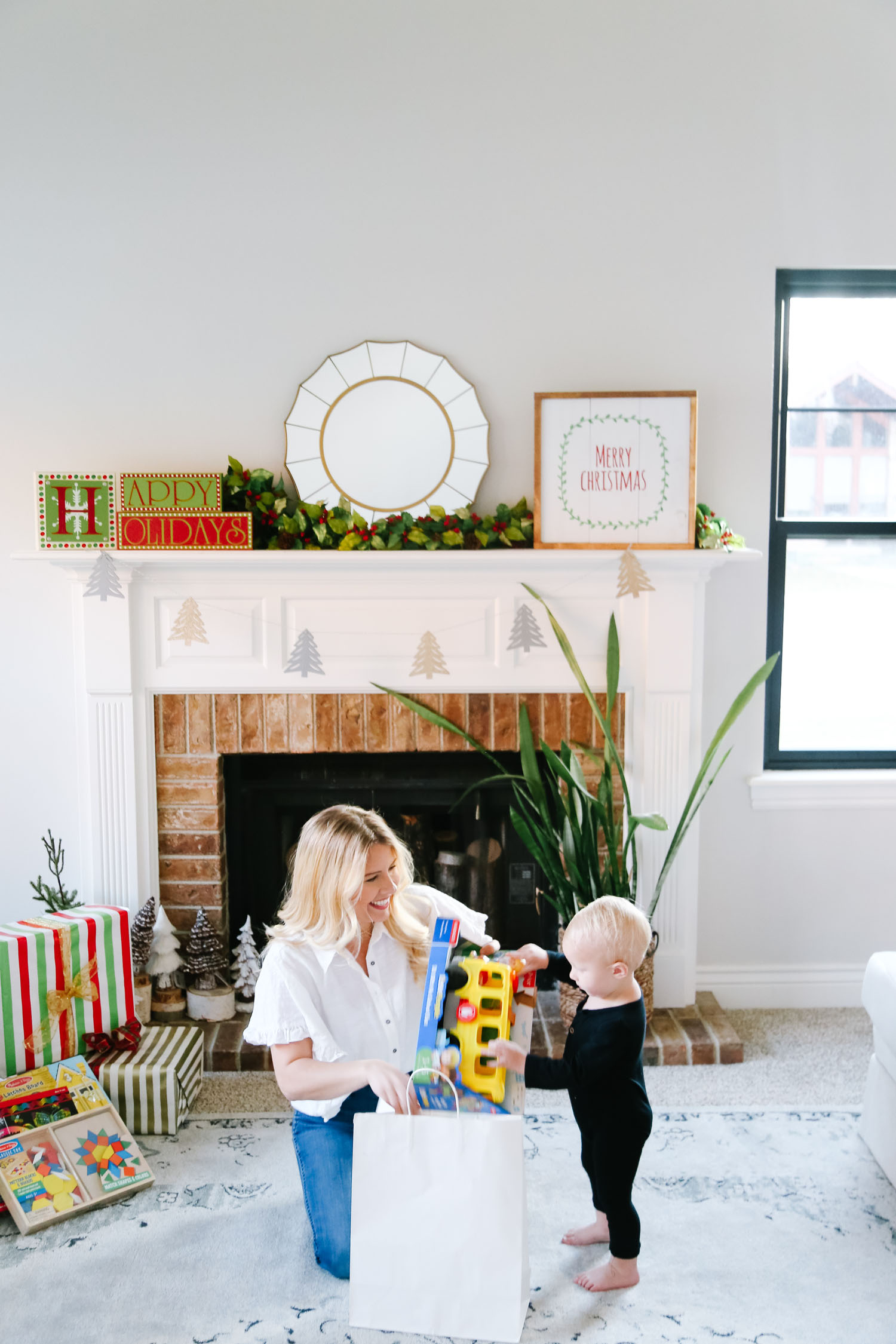 The Best Kohl's Toys your Children will Love, featured by Utah life and style blogger, By Jen Rose: image of a toddler wrapping a Kohl's toy with her mom
