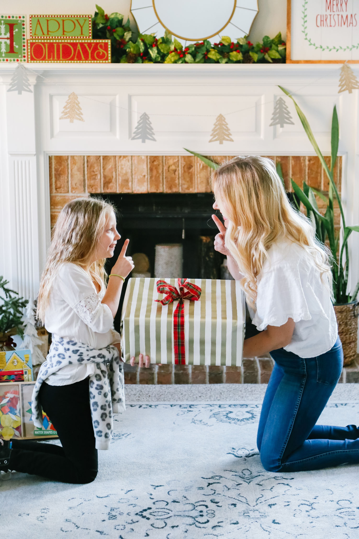 The Best Kohl's Toys your Children will Love, featured by Utah life and style blogger, By Jen Rose: image of a girl wrapping a Kohl's toy with her mom
