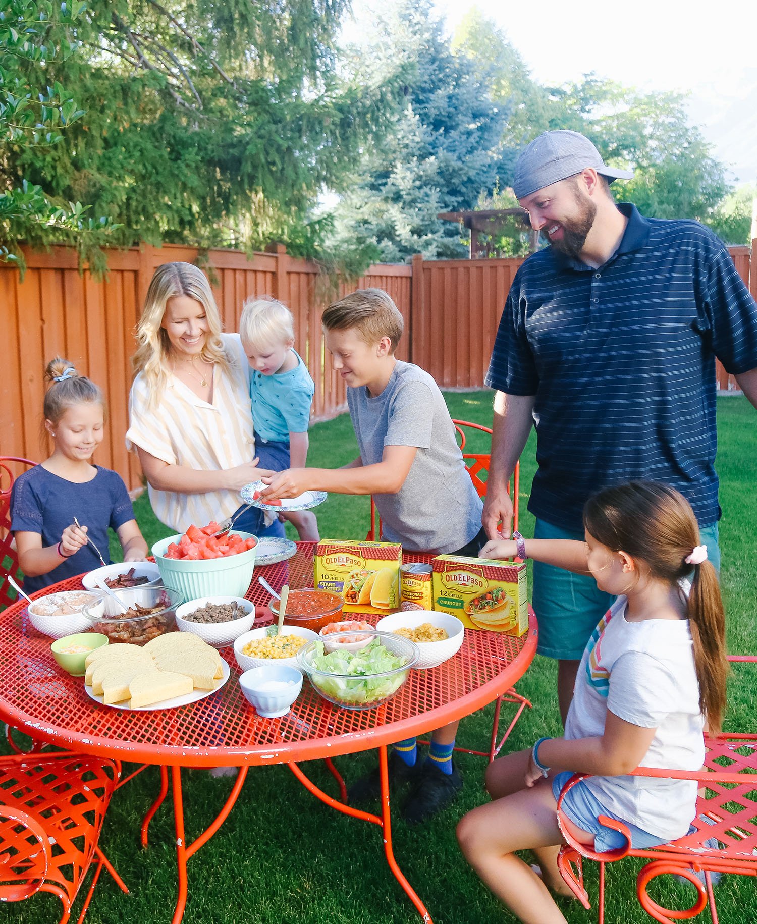 Tips for Hosting a Simple Summer Dinner Party featured by US lifestyle blogger, By Jen Rose: image of a family at their summer dinner party